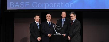 Hans Engel, chairman and CEO, BASF Corporation (second from right), accepts a Supplier of the Year Award from General Motors. From left are Greg Warden, executive director, global engineering body/exterior for General Motors; Joseph Schmondiuk, vice president, global accounts for BASF in North America; Engel; and, Randy Pappal, executive director, global purchasing body/exterior for General Motors.