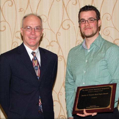 "Rob Storey, co-chair of the Symposium, presented The Shelby F. Thames Best Paper Award to Jens Voepel of Ytkemiska Institute, YKI – Institute for Surface Chemistry for ""Making Cleaner Surfaces."""