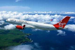 Special effect  coatings by PPG Industries' aerospace coatings group add high reflectivity and vibrant color to the red tail and engines as well as aubergine lettering in Virgin Atlantic's new livery.