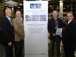 Todd Miller (far right), chairman of the Metal Construction Association (MCA), presents a 2012 Chairman's Award to Chancey Hagerty, business director, building products, for PPG Industries' (NYSE:PPG) coil and extrusion coatings group. Also pictured are (from left) Mark Engel, executive director of MCA, and Andy Koglin AIA, president of OKW Architects in Chicago and a member of MCA's judging panel for the awards. PPG received the Chairman's Award at METALCON, the only annual conference dedicated to metal construction products, technologies and solutions, which is sponsored by MCA. PPG supplied DURANAR(R) VARI-COOL(R) coatings for the award-winning project, Port Pavilion at Broadway Pier in San Diego, which was honored in part for its striking visual appearance and sustainability.