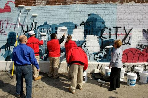 Volunteer efforts to make way for a mural.